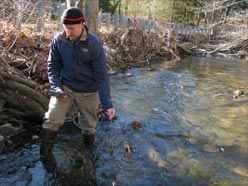 GSWA Volunteer Mike Duffy collects water quality samples from a tributary of the Upper Passaic River