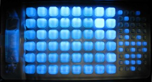 Wells that are yellow and fluoresce are positive for E. coli