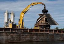 Excavator dredging sludge from Passaic River